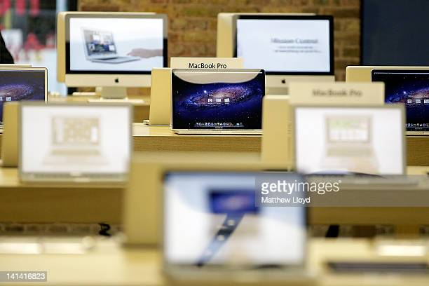 Macbook and iMac computers on display in the Apple Store in Covent Garden on March 16 2012 in London England The new iPad 3 goes on sale today with...