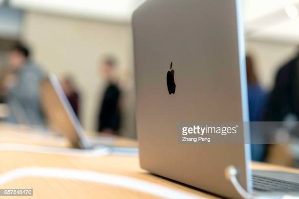 Macbook on table in the new Apple shop On the March 25 Apple opened 3 new retail shop in the world one of them is located in Nanjing Jinmao Plaza...