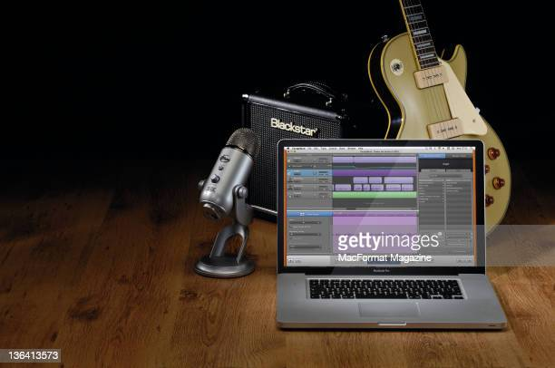A MacBook Pro laptop with GarageBand software and musical equipment Bath March 23 2011