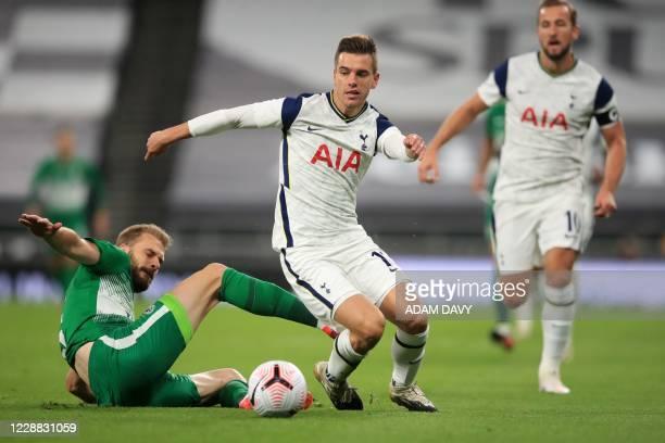Maccabi Haifa's Serbian defender Bogdan Planic challenges Tottenham Hotspur's Argentinian midfielder Giovani Lo Celso during the UEFA Europa League...
