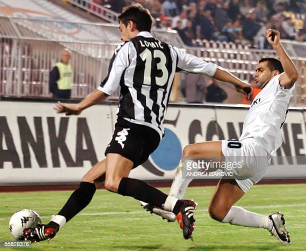 Maccabi Petach Tikva's Toama Salim vies with Partizan Belgrad's Lomic Marko during their UEFA Cup first round second leg football match 29 September...