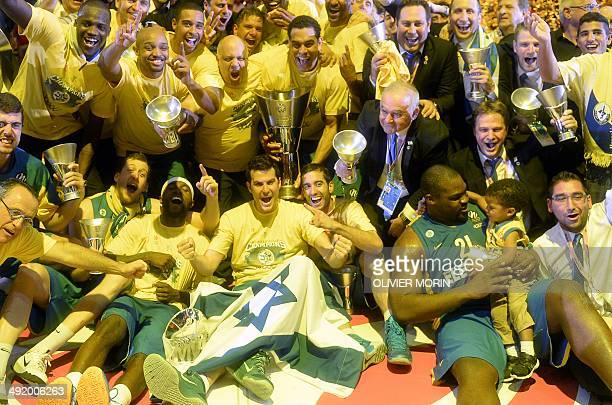 Maccabi Tel Aviv players celebrate their victory at the end of their Euroleague 2014 3rd place Final Four basketball game against Real Madrid, on May...