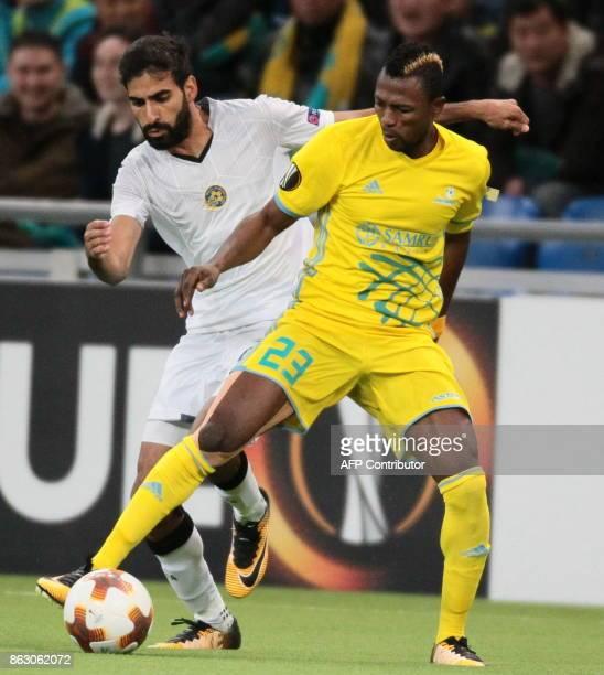 Maccabi Tel Aviv's defender from Israel Ofir Davidazde and Astana's forward from Ghana Patrick Twumasi vie for the ball during the UEFA Europa League...