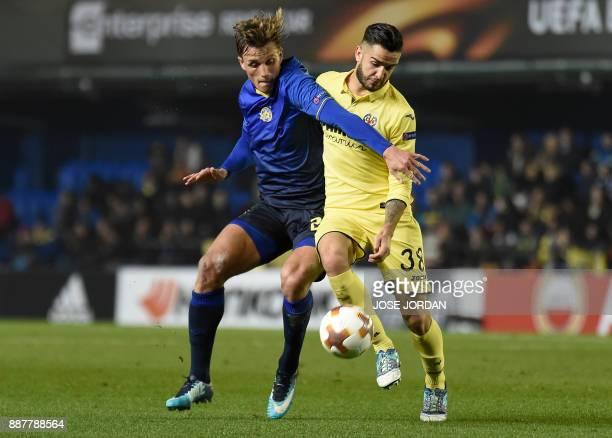 Maccabi Tel Aviv's forward Aaron Schoenfeld challenges Villarreal's midfielder Genis Montolio during the UEFA Europa League group A football match...