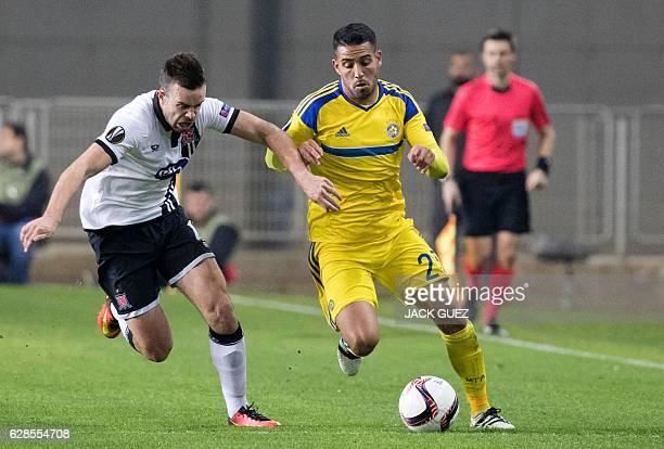 Maccabi Tel Aviv's Israeli defender Eli Dasa vies for the ball against Dundalk's Irish midfielder Robbie Benson during the UEFA Europa League group D...