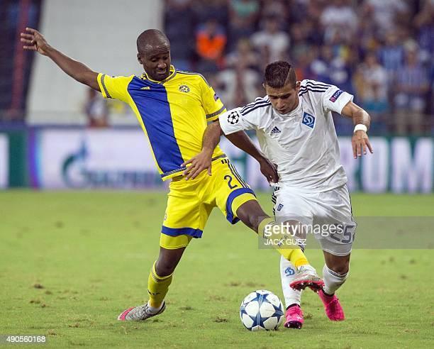 Maccabi Tel Aviv's Israeli defender Eliazer Dasa vies with Dynamo Kyiv's Paraguayan midfielder Derlis Donzales during the UEFA Champions League,...