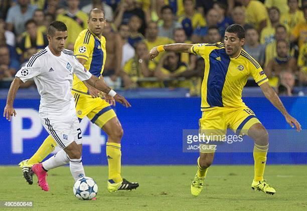 Maccabi Tel Aviv's Israeli defender Eytan Tibi and Dynamo Kyiv's Paraguayan midfielder Derlis Donzales vie for the ball during the UEFA Champions...