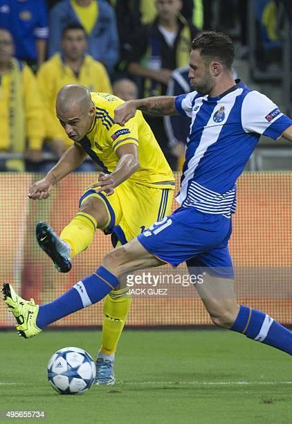 Maccabi Tel Aviv's Israeli forward Tal Ben Haim II vies against FC Porto's Mexican defender Miguel Layun during the UEFA Champions League group G...