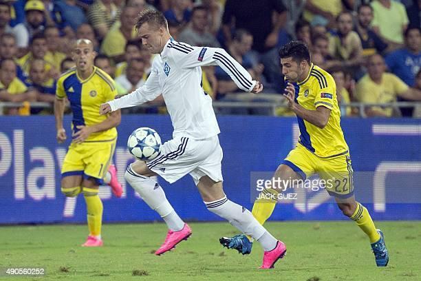 Maccabi Tel Aviv's Israeli midfielder Avraham Rikan vies with Dynamo Kyiv's Ukrainian forward Andriy Yarmolenko during the UEFA Champions League,...