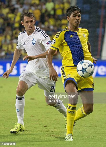 Maccabi Tel Aviv's Israeli midfielder Dor Peretz and Dynamo Kyiv's Brazilian defender Danilo Silva vie for the ball during the UEFA Champions League,...