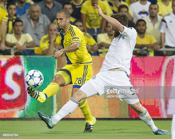 Maccabi Tel Aviv's Israeli midfielder Gil Vermouth and Dynamo Kyiv's Portuguese defender Antunes vie for the ball during the UEFA Champions League,...