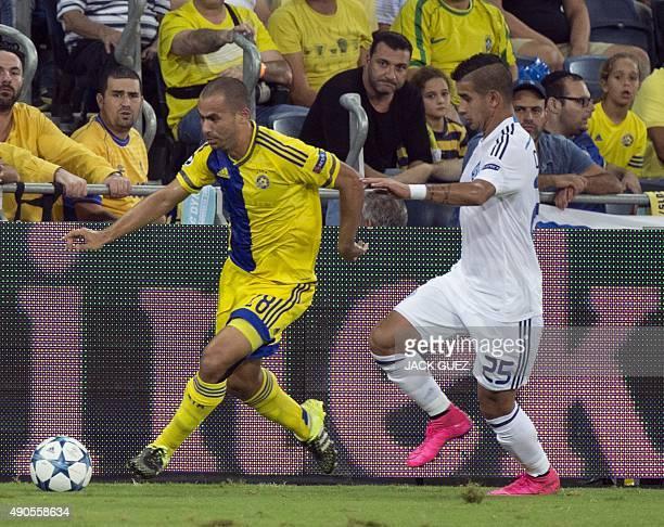 Maccabi Tel Aviv's Israeli midfielder Gil Vermouth vies against Dynamo Kyiv's Paraguayan midfielder Derlis Donzales during the UEFA Champions League,...