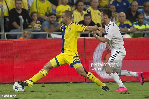 Maccabi Tel Aviv's Israeli midfielder Gil Vermouth vies against Dynamo Kyiv's Ukrainian midfielder Serhiy Rybalka during the UEFA Champions League,...
