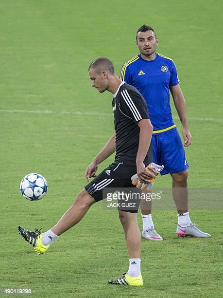 Maccabi Tel Avivs Serbian goalkeeper Predrag Rajkovic and Serbian midfielder Nikola Mitrovic take part in a training session at the Sammy Ofer...