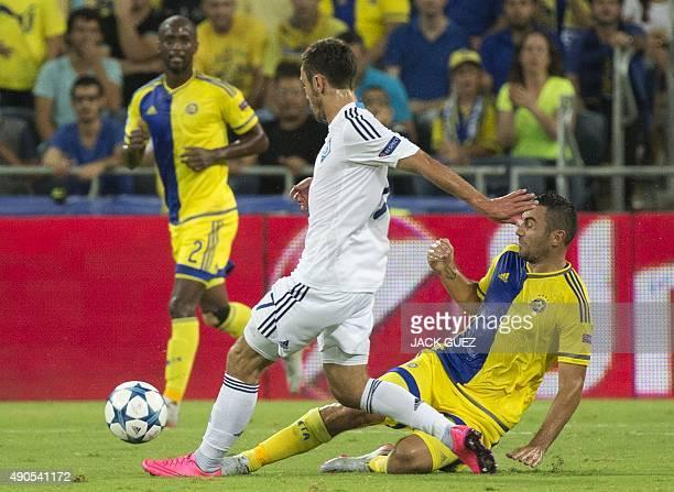 Maccabi Tel Aviv's Serbian midfielder Nikola Mitrovic and Dynamo Kyiv's Portuguese defender Antunes vie for the ball during the UEFA Champions...