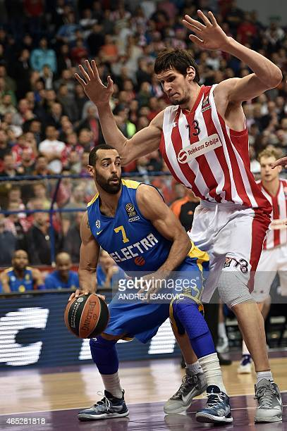 Maccabi Tel Avivs US forward Brian Randle vies with Red Star Belgrade's center Boban Marjanovic during the Euroleague Top 16 basketball match between...