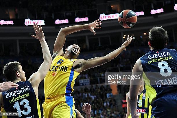 Maccabi Tel Aviv`s US forward Devin Smith vies for the ball with Fenerbahce Ulker`s Serbian forward Nemanja Bjelica and Serbian forward Bogdan...