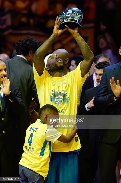 Maccabi Tel Avivs US guard Tyrese Rice , MVP of the Final Four , celebrates with his son his team's victory after their Euroleague 2014 Gold medal...