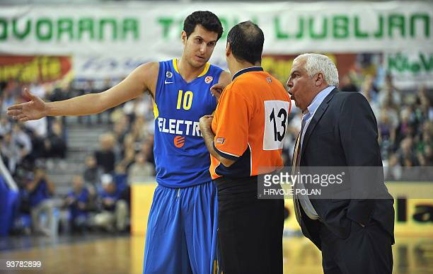 Maccabi's coach Pini Gershon and basketball player Guy Pnini argue with referee during their Euroleague basketball match against Olimpija at Tivoli...