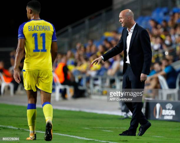 Maccabi's Dutch manager Jordi Cruyff reacts during the UEFA Europa League Group A football match between Maccabi Tel Aviv and Villarreal at the...