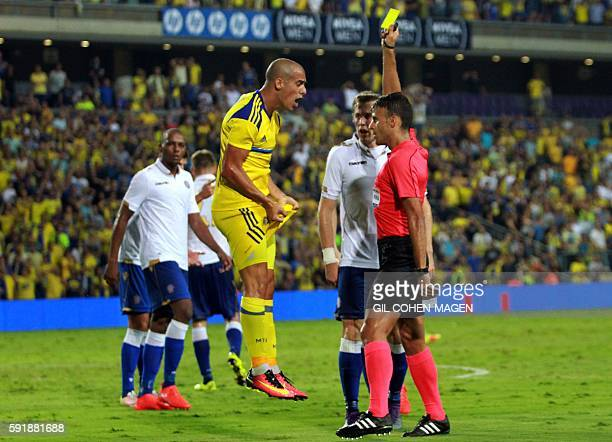 TOPSHOT Maccabi's forward Tal Ben Haim reacts as he receives a yellow card from Spanish referee Jesus Gil Manzano during the qualifying football...