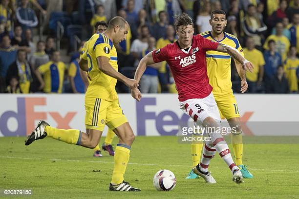 Maccabi's Israeli defender Tal Ben Haim vies for the ball with Alkmaar's Dutch forward Wout Weghorst during their UEFA Europa League football match...