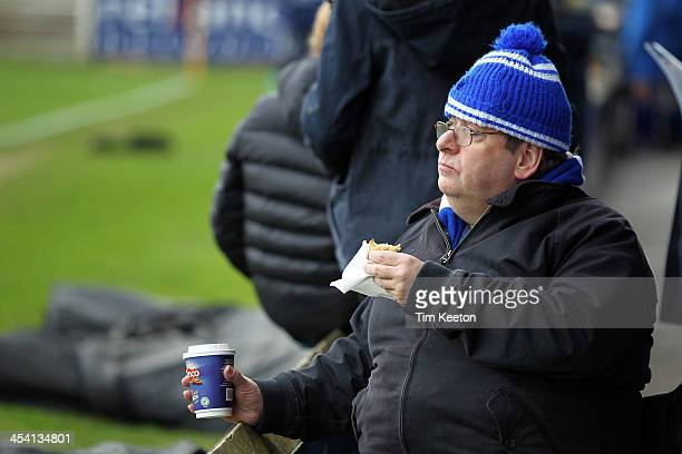 Macclesfield Town fan enjoys a pie during the The FA Cup with Budweiser Second Round match between Macclesfield Town and Brackley Town at The Moss...