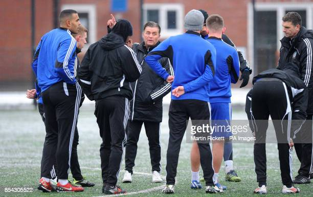 Macclesfield Town manager Steve King talks to his players during the training session at Egerton Football Club Knutsford Cheshire