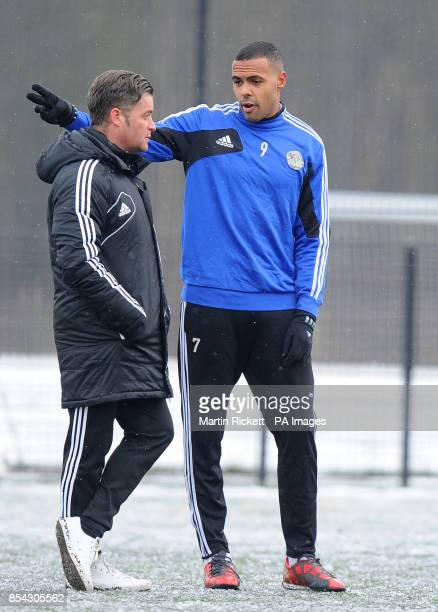 Macclesfield Town manager Steve King talks with Matthew BarnesHomer during the training session at Egerton Football Club Knutsford Cheshire