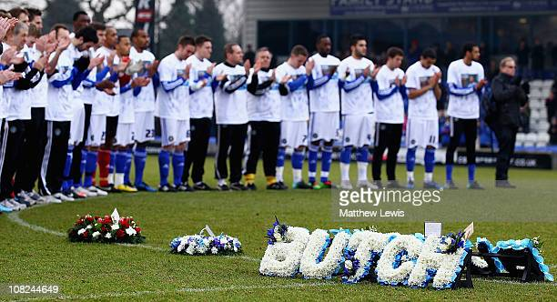 Macclesfield Town players pay their respects to former player Richard Butcher as a wreath is layed on the pitch during the npower League Two match...