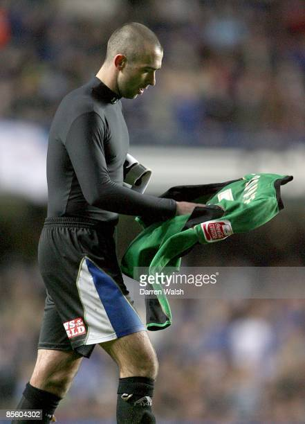 Macclesfield Town's David Morley puts on the goalkeepers shirt after Tommy Lee was dismissed after a challenge on Chelsea player Andriy Shevchenko