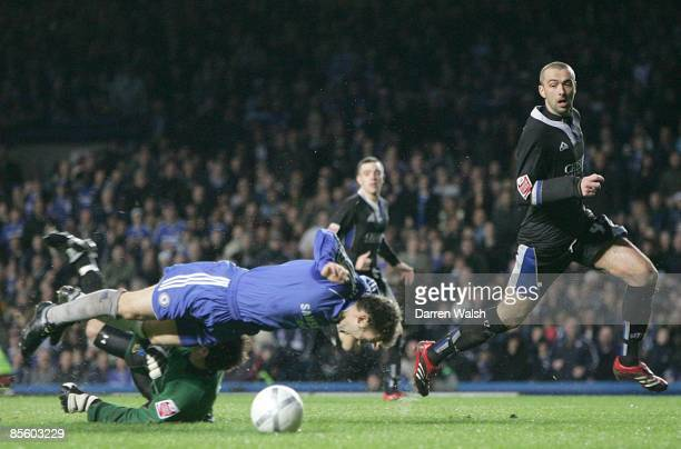 Macclesfield Town's goalkeeper Tommy Lee fouls Chelsea's Andriy Shevchenko