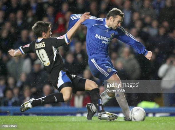 Macclesfield Town's James Jennings challenges Chelsea's Andriy Shevchenkofor the ball