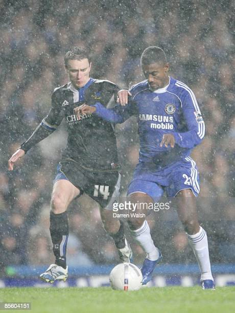 Macclesfield Town's Kevin McIntyre goes to foul Chelsea's Salomon Kalou