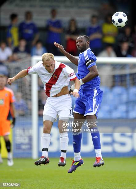 Macclesfield Town's Nat Brown and FC United's Nicky Platt contest a header