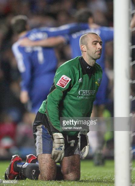 Macclesfield Town's replacement goalkeeper David Morley sits dejected as Chelsea's Frank Lampard scores his third goal