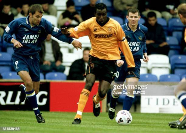 LR Macclesfield's Richard Tracy and Hull City's Theodore Whitmore battle for the ball