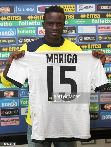 MacDonald Mariga poses with the club shirt during a press conference at the club's training ground on February 1 2013 in Collecchio Italy