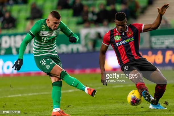 MacDonald Niba of Budapest Honved blocks the shot from Oleksandr Zubkov of Ferencvarosi TC during the Hungarian OTP Bank Liga match between...