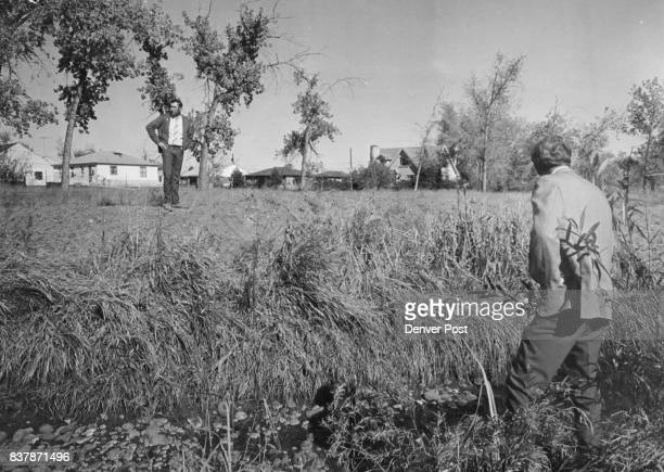 MacDougall left and Worth Coalson assistant director of environmental health division of Jeffco Health Department inspect stagnant branch of Clear...