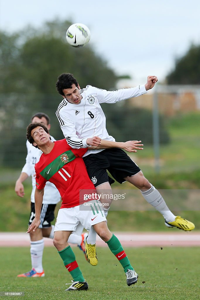 Macedo of Portugal challenges Levin Oztunali of Germany during the Under17 Algarve Youth Cup match between U17 Portugal and U17 Germany at the Stadium Bela Vista on February 12, 2013 in Parchal, Portugal.