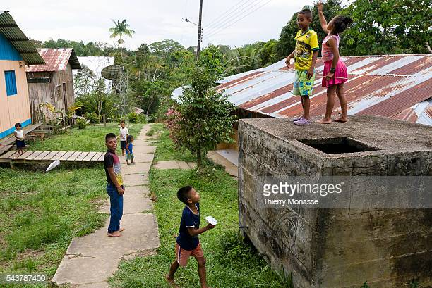 Macedonia department of Amazonas Republic of Colombia August 10 2015 Children's are playing with Paper plane in the street