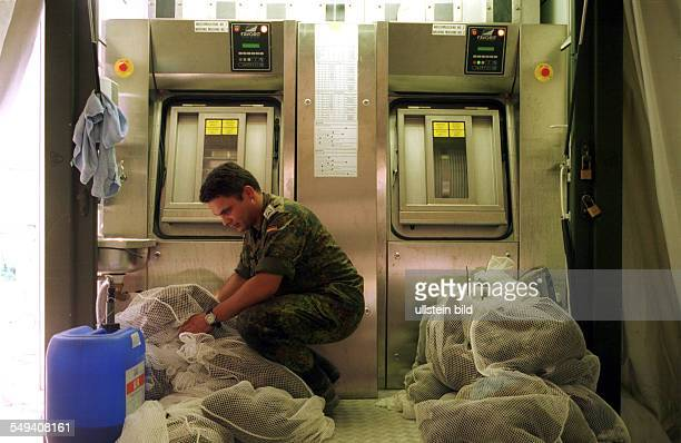 Macedonia Tetovo Soldiers of the German armed Forces at the Kuzman Josifovski Pitu barracks in Tetovo Cleaning of the uniforms