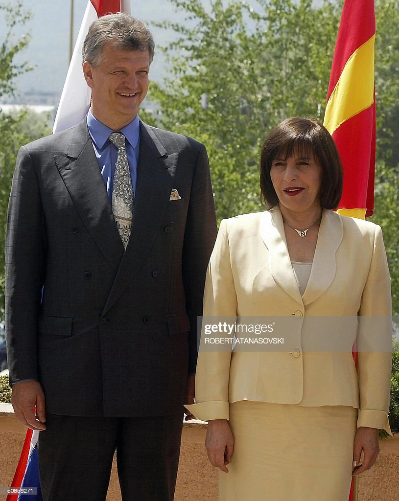 Macedonian Foreign Minister Ilinka Mitreva (R) greets her Croatian counterpart Miomir Zuzulj during the second meeting of the Adriatic Charter, held in the Macedonian capital Skopje 20 May 2004. The Adriatic Charters is a US sponsored partnership initiative between Balkan NATO hopefuls Macedonia, Croatia and Albania.