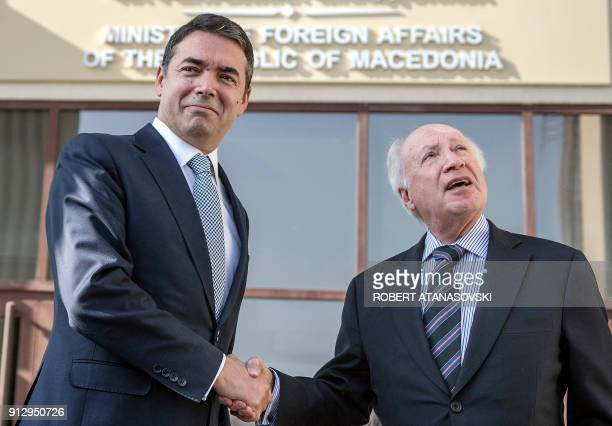 Macedonian Foreign Minister Nikola Dimitrov shakes hands with United Nations mediator Matthew Nimetz during their meeting in Skopje on February 1...