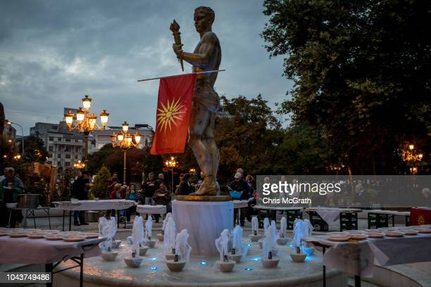 Macedonian national flag hangs from a statue at a gathering of supporters of the movement to boycott the referendum vote on September 30, 2018 in...