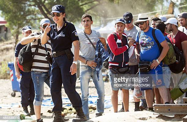 Macedonian police allow migrants to pass near the GreeceMacedonia near the town of Gevgelija on August 27 2015 Serbia and Macedonia's foreign...