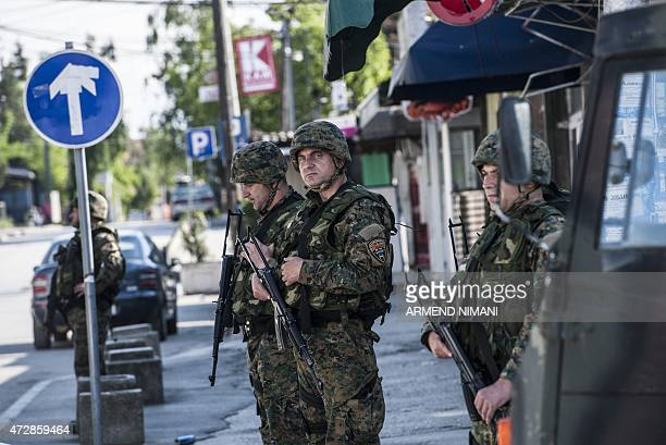 Macedonian police officers block a street in the town of Kumanovo on May 10 2015 Shooting broke out for a second day on May 10 in north Macedonia as...