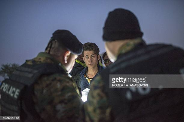 Macedonian police officers control the identification informations of Afghanistan refugees at the GreekMacedonian border near Gevgelija on November...