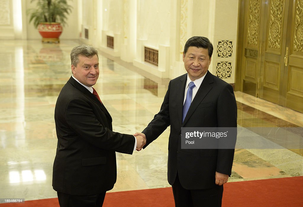 Macedonian President Gjorge Ivanov (L) shakes hands with Chinese President Xi Jinping (R) before a meeting at the Great Hall of the People on October 21, 2013 in Beijing, China.